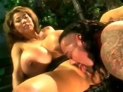 Big breasts Asian sucks his dick in the parkland