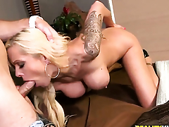 Blonde with monumental breasts and hairless snatch fucking herself with dildo