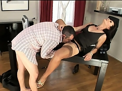 Nympho secretary in nylons trades devotee round her boss man at work